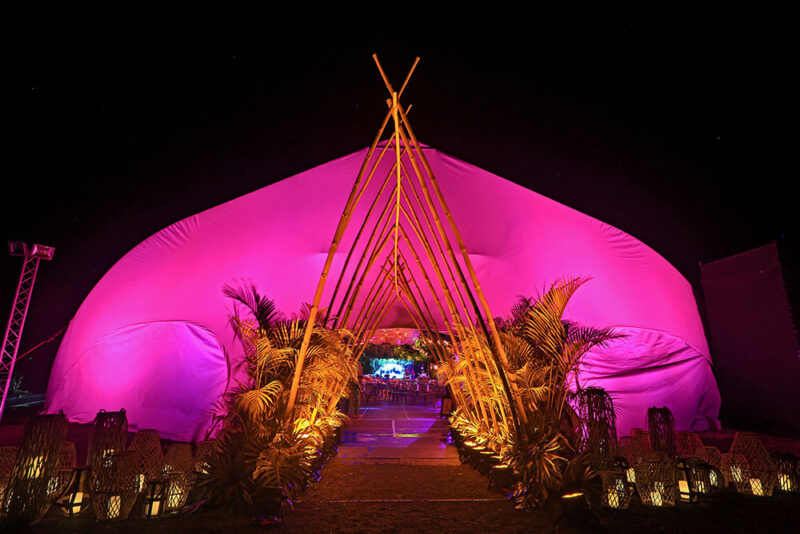 Luxury outdoor event tent with bamboo entrance at Marina Esplanade, Andaz Papagayo