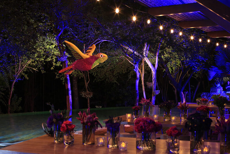Table décor and hanging hummingbird floral sculpture.