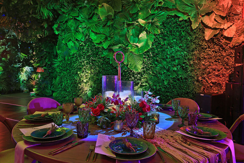 Tablescape with background of rainforest decorated walls.