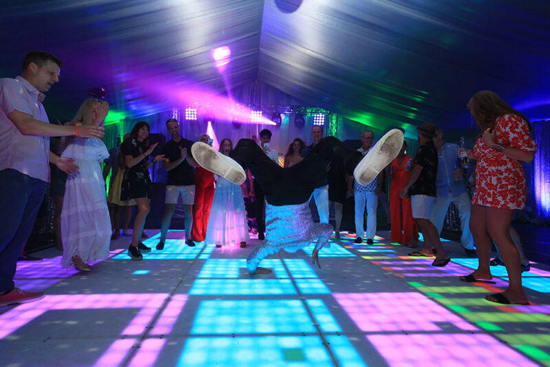 Break dancer on LED dance floor