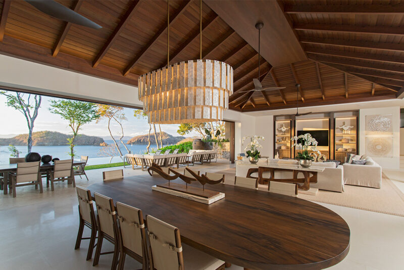 Marble finishes and a seashell inspired chandelier blends with the Golden hour scene. - 8 Monos | Peninsula Papagayo