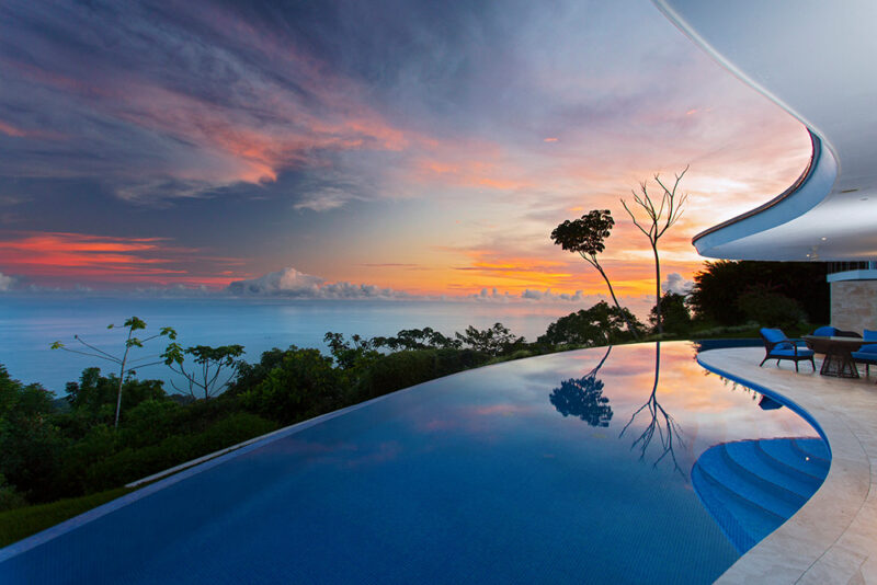 Infinity pool enhanced by majestic sunset - Casa de Luz | Costa Verde Estates
