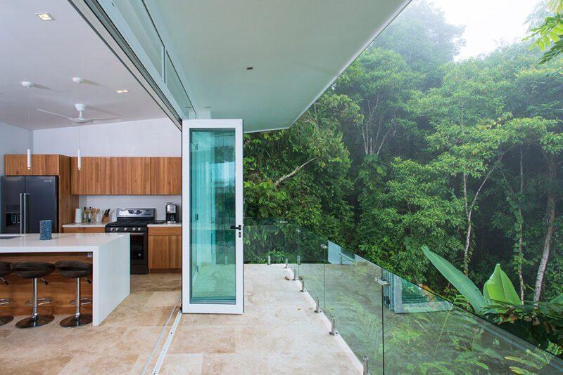 Sliding doors frame the landscape offering a unique connection with nature - Casa de Luz | Costa Verde Estates